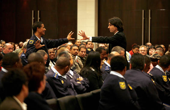 Dr John Demartini works with South African Police Services